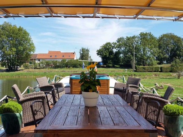 The spacious and partially canopied sundeck aboard the Saroche offers a wonderful space<br> to relax and enjoy the passing vistas or an alfresco meal