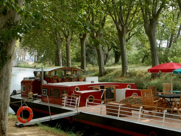 The Savannah moored under a canopy of sycamore trees along the Canal du Midi