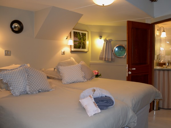 The Laurgais Suite and ensuite bathroom with shower shown above and below