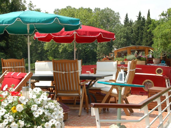 The lovely tiled deck on the Savannah is a great place to lounge under shade and for dining alfresco