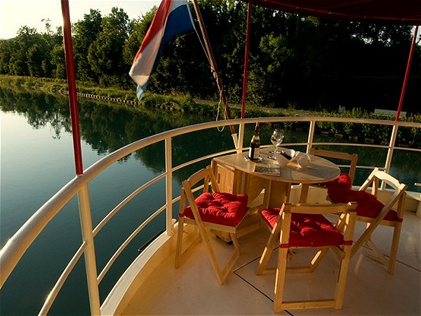 The canopied rear sundeck is perfect for enjoying the passing vistas along the canal