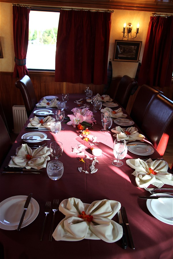 The dining room is always beautifully set for every meal aboard the Scottish Highlander