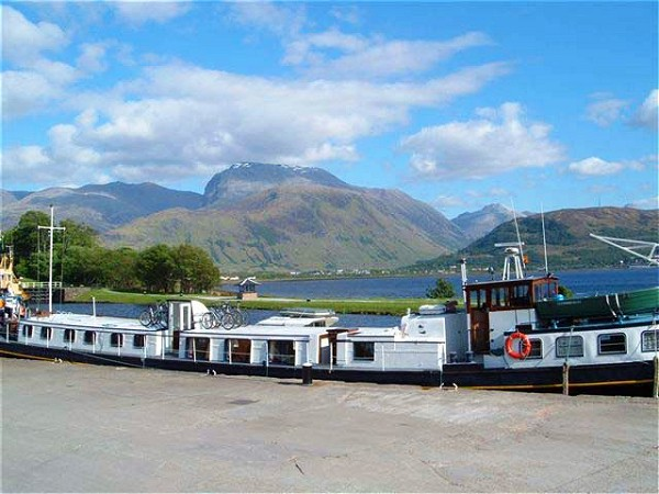 Scottish Highlander moored with views of Ben Nevis,<br>the highest mountain in the British Isles.