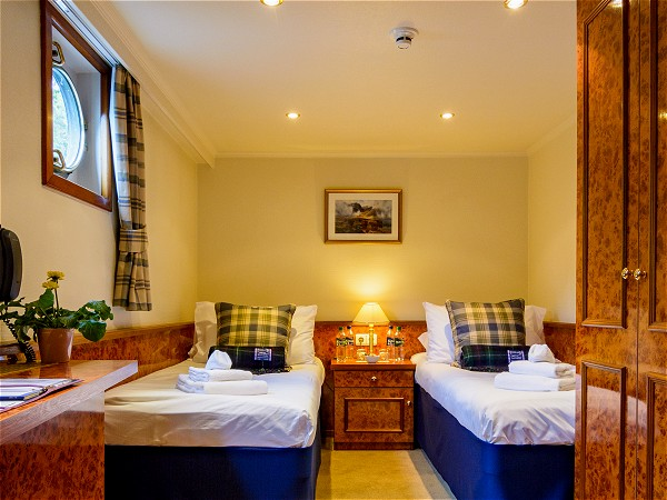All cabins aboard the Spirit of Scotland can be configured with<br>two twin beds or a queen size bed.