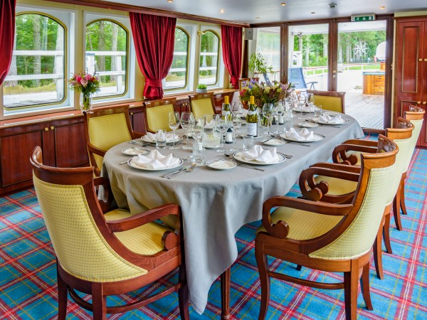 The dining room aboard the Spirit of Scotland opens up to the rear deck with spa pool