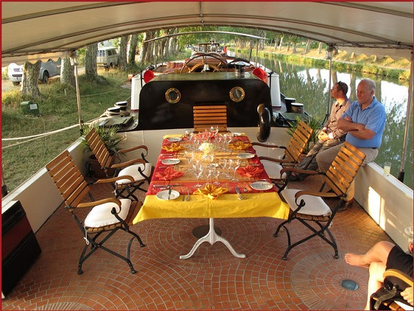 The canopied sundeck aboard the Tango is perfect for an alfresco meal